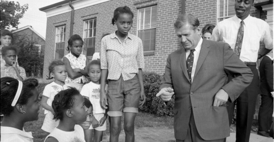 Image of Governor Terry Sanford talking to African American school children