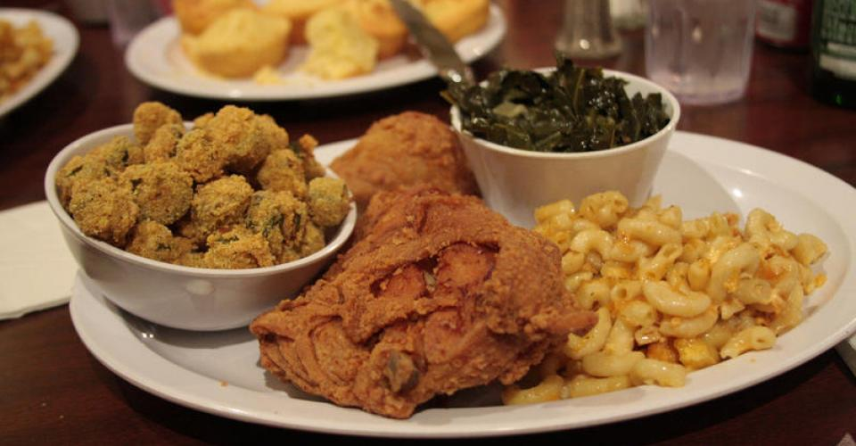 Image of fried chicken, macaroni & cheese, fried okra, and collard greens